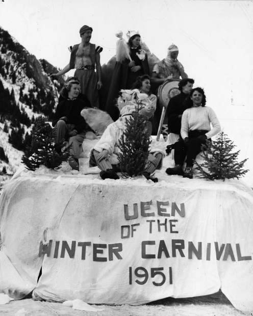 The first Wintersköl parade in 1951, with the first queen Ellie Whitten, aka Ellie Spence and Gale Spence, and runners-up. The float has a missing