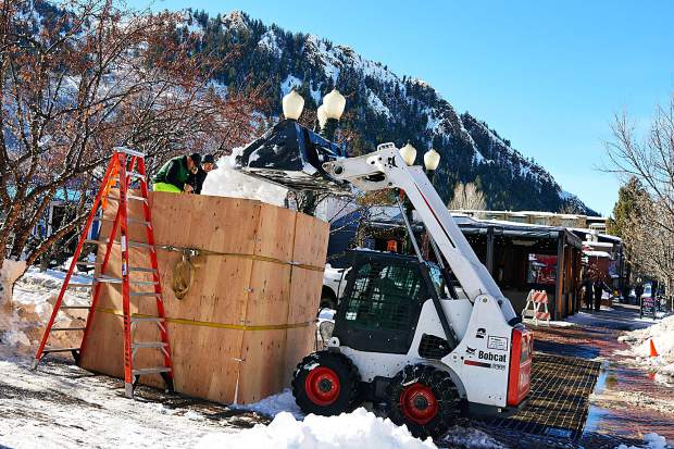 Aspen Parks Department workers fill wooden molds with snow to create blocks for snow sculptures for Winterskol this weekend.