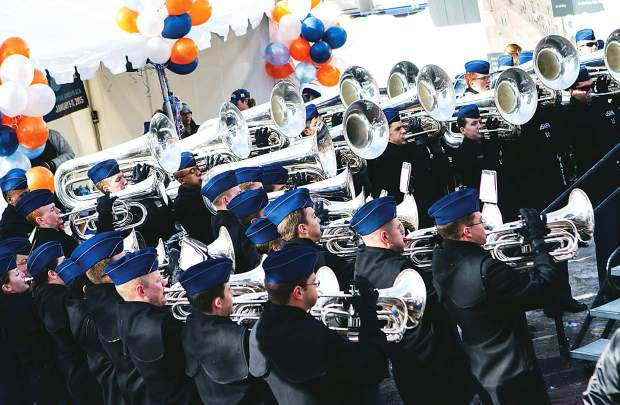 Members of the U.S. Air Force Drum and Bugle Corps perform in front of a large crowd at Wagner Park during Winterskol events in 2015.