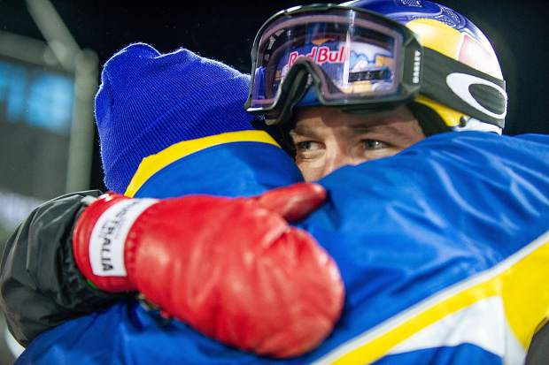 Scotty James gives a hug to a loved one Sunday night after winning the snowboard superpipe finals at X Games.