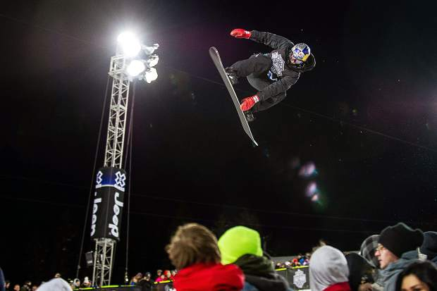 Australian snowboarder Scotty James competes in the men's snowboard superpipe final Sunday night at Buttermilk for X Games. James took first place.