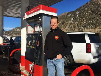 Business Monday: Low gas prices pump up business at Woody Creek Station