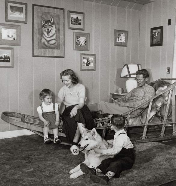 The Mace family in 1949. Lynne is seated with her mother, Isabel, and father Stuart. Young Greg is on the floor with the dog.