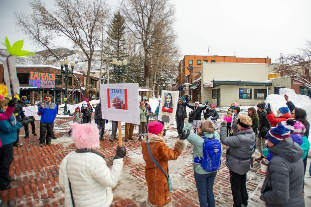 Men and women gather in the pedestrian mall in Aspen on Saturday for the third annual Women's Ski and March for Decency and Truth. The event was hosted by Pitkin County Democrats and had an assortment of speakers at Paepcke Park including Colorado State Representative Julie McCluskie.
