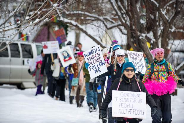 Men and women march to Paepcke Park in Aspen on Saturday for the third annual Women's Ski and March for Decency and Truth. The event was hosted by Pitkin County Democrats and had an assortment of speakers including Colorado State Representative Julie McCluskie.