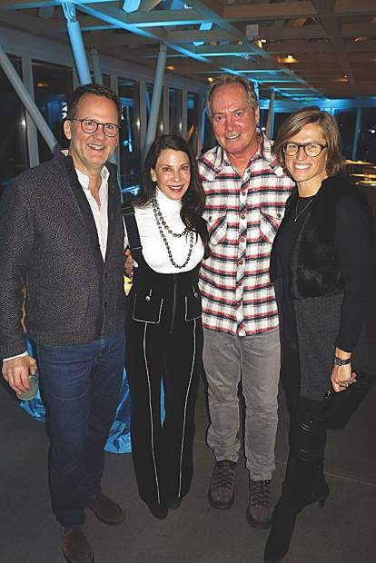 John Rowland in Ferragamo shoes, Erin Pariser in a Chanel jumpsuit, Paul Pariser in a Chrome Hearts flannel, and Sarah Broughton wearing Blake Kuwahara optics.