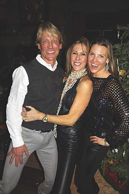 David Rogers, Wendy Wogan and Lyndsay Meyer at a house party.
