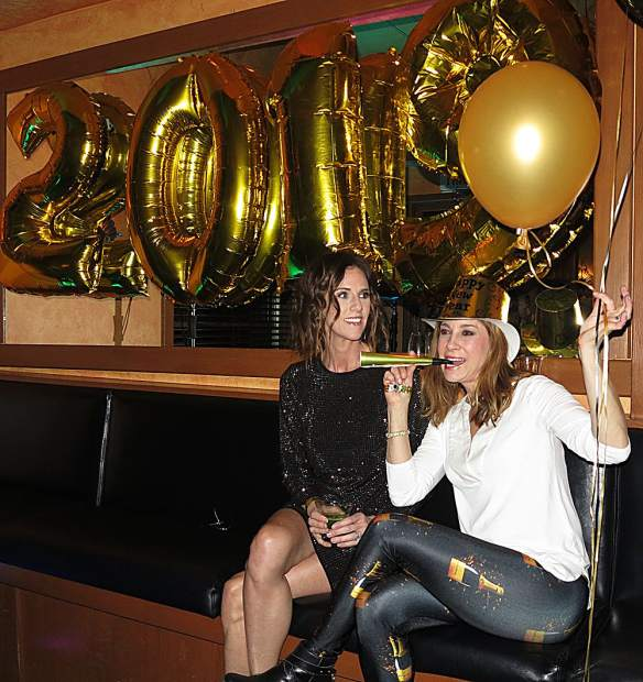 Sarah Korpela and Heather Kroeger get into the New Year's Eve spirit.