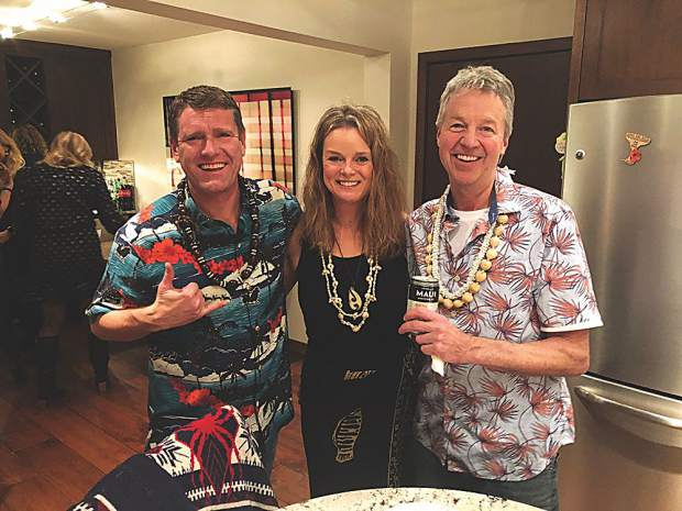 Danny Becker, Heidi Kowar and Bob Bindseil at a Mele Kalikimaka Hawaiian holiday party.