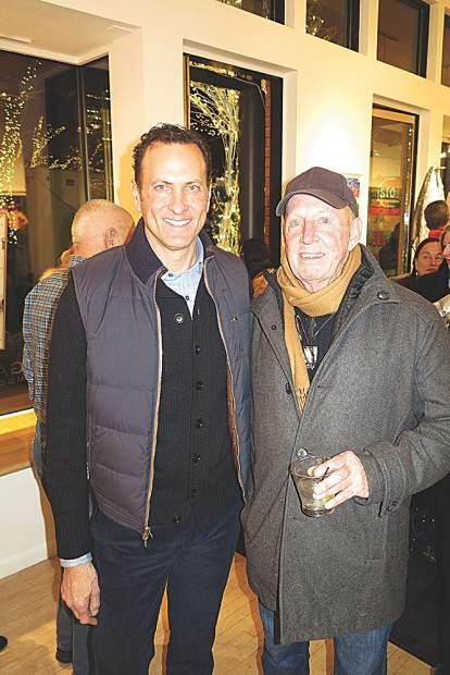 Galerie Maximillian owner Albert Sanford with guest David Marlow at an art reception.
