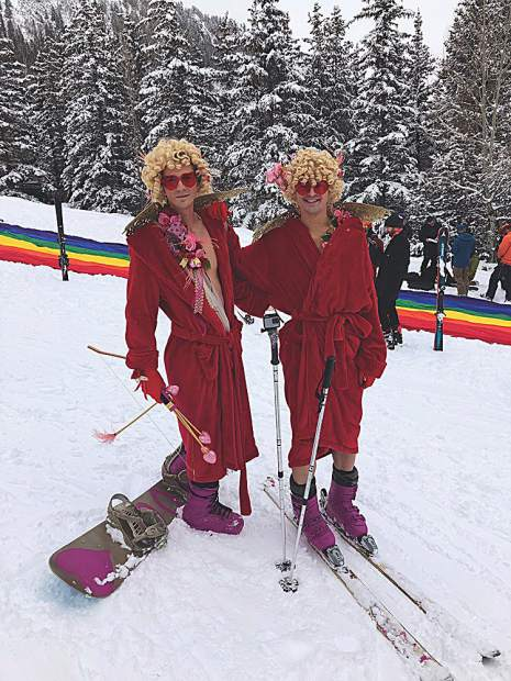 A Cupid snowboarder and skier getting ready to work their magic in the Downhill Costume Contest.
