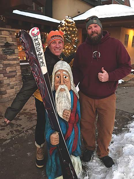 Danny Danko, GM of the Annabelle Inn, poses with a new Father Time for the hotel, carved by Joe Wenel of Rocky Mountain Carvers. Courtesy photo.
