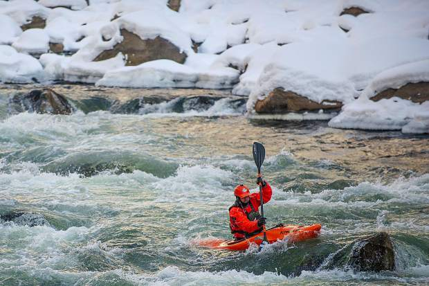 Peter Holcombe on the last rapid on Shoshone of the Colorado River in Glenwood Springs for the annual paddle event on New Year's Day.
