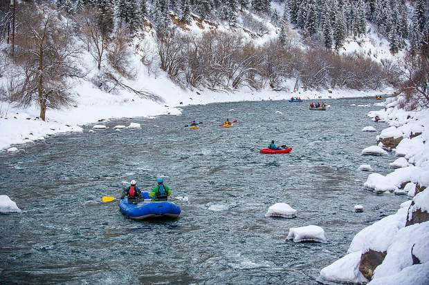 Whitewater boaters on the Shoshone section of the Colorado River in Glenwood Springs for the annual paddle event on New Year's Day.