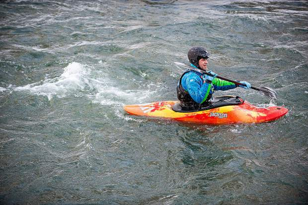 Danny Bacheldor paddles in the annual New Year's Day float down the Shoshone section in Glenwood Canyon on the Colorado River Jan. 1, 2019.