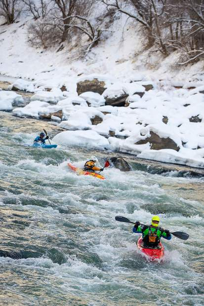 Kayakers go through Maneater Rapid at the annual New Year's Day float down the Shoshone section in Glenwood Canyon on the Colorado River Jan. 1, 2019.