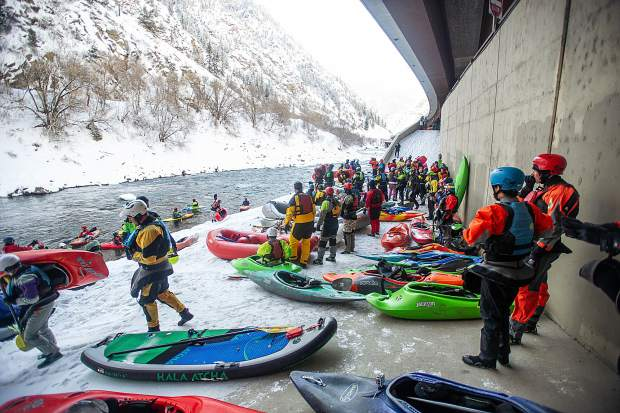 Paddlers prepare for the annual New Year's Day float down Shoshone in Glenwood Canyon on the Colorado River Jan. 1, 2019.