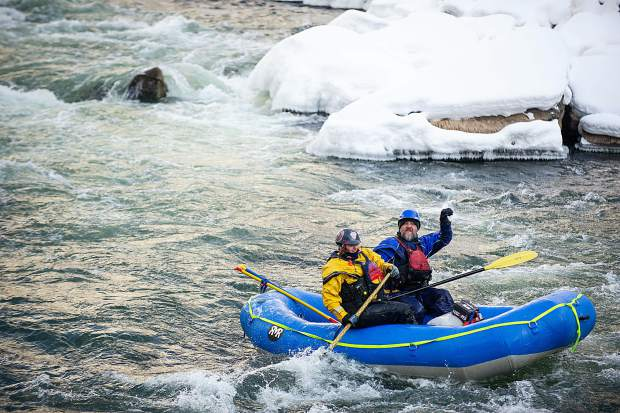 Rafters make their way down the river at the annual New Year's Day float on the Shoshone section in Glenwood Canyon on the Colorado River Jan. 1, 2019.