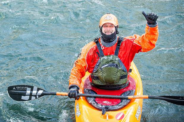 Peter Holcombe gives a thumbs up after finishing the rapids on Shoshone of the Colorado River in Glenwood Springs for the annual paddle event on New Year's Day.