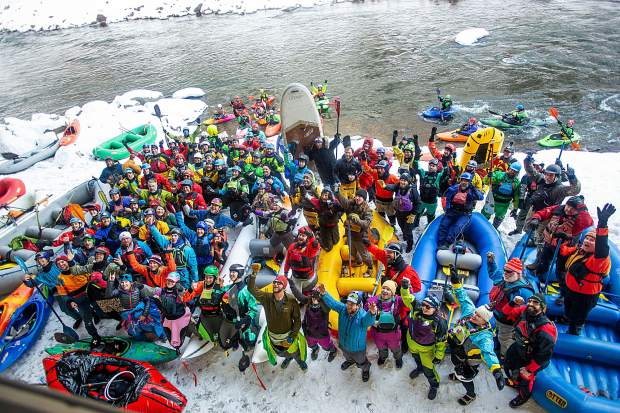 Whitewater boaters gather at the put-in of the Shoshone section of the Colorado River in Glenwood Springs for the annual paddle event on New Year's Day.