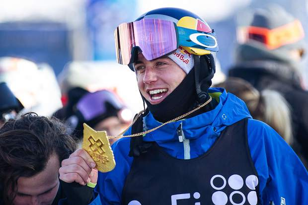 Canadian snowboarder Mark McMorris holds his gold medal after taking first place in the men's slopestyle finals in Aspen for X Games on Saturday.