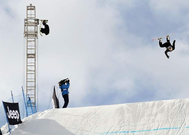 Winner Zoi Sadowski-Synnott of New Zealand gets inverted during the X Games Aspen women's snowboard slopestyle finals on Saturday, Jan. 26, 2019, at Buttermilk Ski Area. (Photo by Austin Colbert/The Aspen Times)