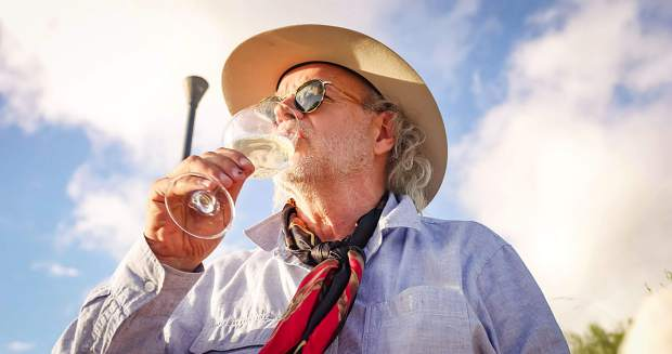 World renowned chef Francis Mallmann sips white wine from Bodega Garzón under the sun in Uruguay during a shoot for