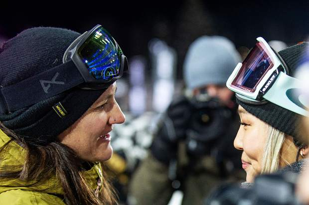 Kelly Clark, left, chats with Chloe Kim after the women's snowboard superpipe final at Buttermilk on Saturday night. Kim won the gold in the finals. Clark announced her retirement from competitions on Saturday night.