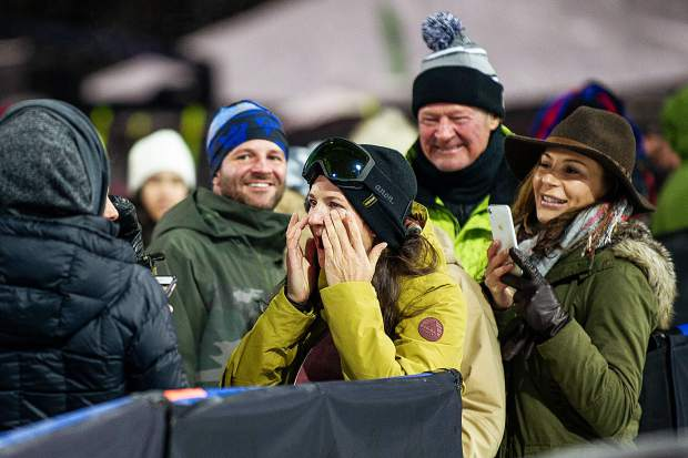 Kelly Clark wipes away tears surrounded by family and friends after taking her retirement announcement lap through the X Games' superpipe on Saturday night.