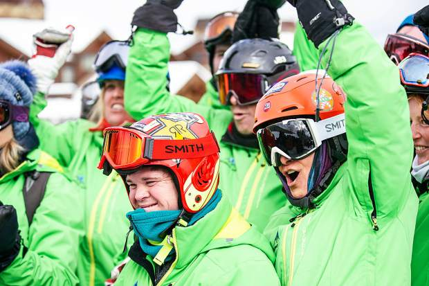 Challenge Aspen Members holler at the final for the Special Olympics Unified Snowboarding final event at Buttermilk on Thursday.