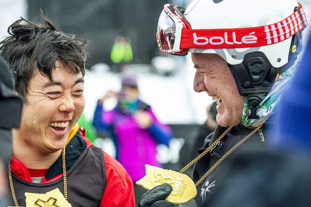 Aspen local Chris Klug, right, shares a laugh with his Special Olympics Unified Snowboard partner Henry Meece after winning the final competition on Thursday afternoon at the X Games Buttermilk venue.
