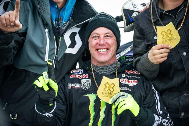 Doug Henry holds up his gold medal after winning para snow bikecross finals at X Games in Aspen on Saturday.