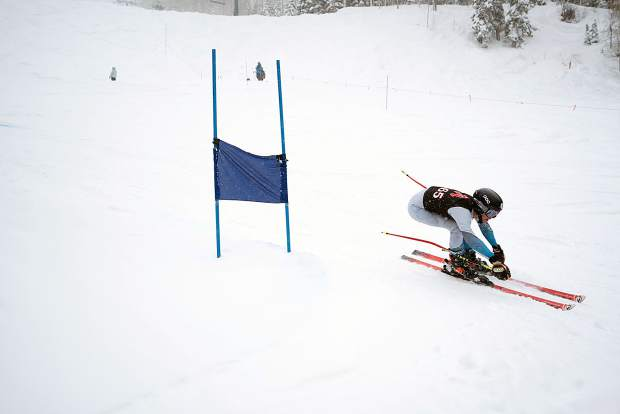 Aspen's Reed Beidelman tucked into form during Thursday's giant slalom state championship race at Purgatory Resort north of Durango.