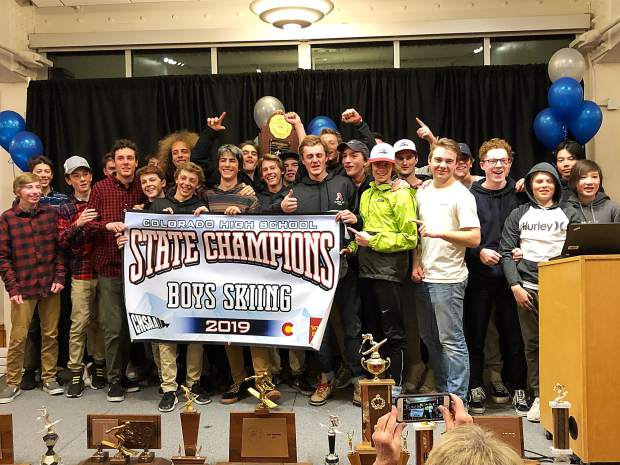 The Aspen High School boys ski team poses for photos after winning the 2019 state championship on Friday in Durango. It was the second state title in as many years for the Skiers. (Bethany Brookens/CHSAANow.com).