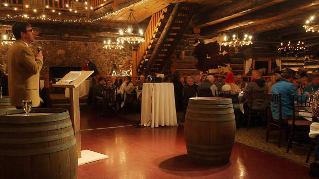 Executive director Mark Godomsky gives out introductions during the Aspen Valley Ski and Snowboard Club hall of fame dinner at the T-Lazy-7 Ranch on Saturday, Feb. 23, 2019. (Photo by Austin Colbert/The Aspen Times).
