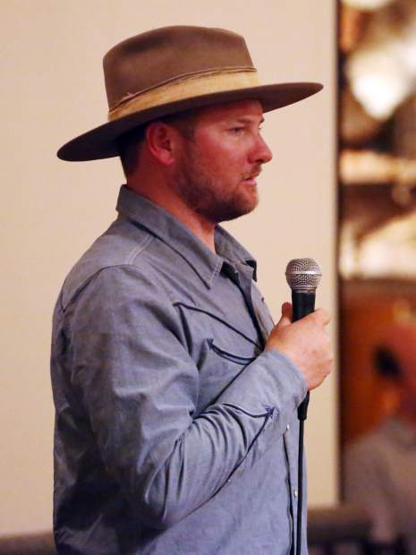 Cody Oates speaks during the Aspen Valley Ski and Snowboard Club hall of fame dinner at the T-Lazy-7 Ranch on Saturday, Feb. 23, 2019. (Photo by Austin Colbert/The Aspen Times).
