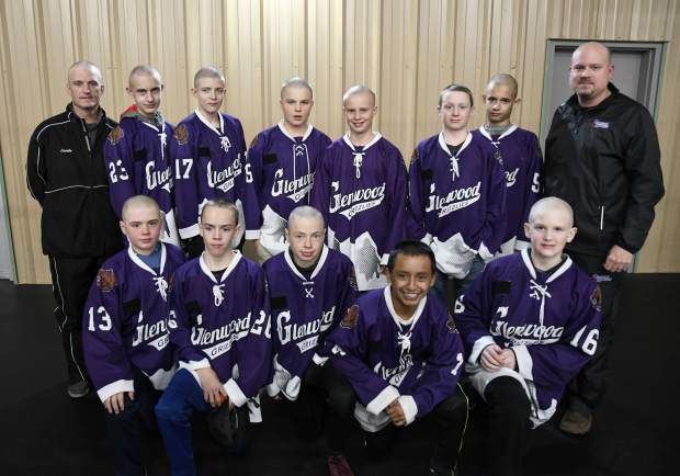 The Glenwood Grizzly Bantam Hockey team pose for a picture after they shaved their heads Thursday.