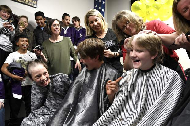 Members of the Glenwood Grizzly Bantam Hockey team have a laugh as they get their heads shaved Thursday in Glenwood Springs. The team shaved their heads for Anna Cunningham, a Basalt High School student who is battling cancer. Anna's brother Cooper Cunningham , far right, and his teammates have raised over $4,000.
