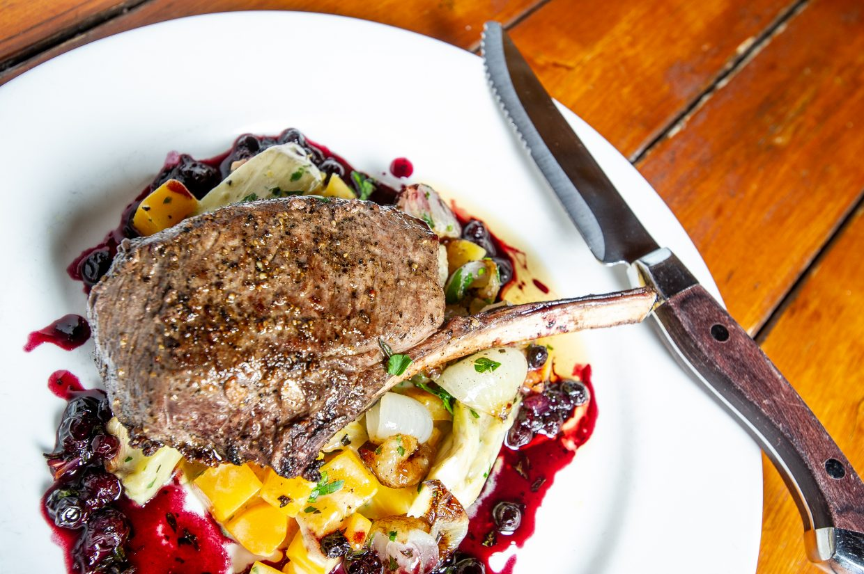 Rocky Mountain elk chop served with butternut squash and huckleberry sauce.