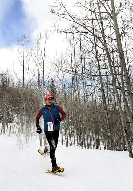 Snow flies as Heidi Vosbeck barrels down Babbish Gulch toward the finish line Sunday. Vosbeck was the top finisher on the women's side of the event.
