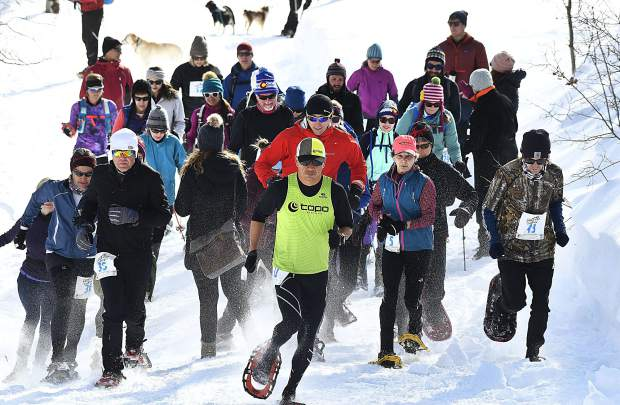 Competitors burst off the start line on their way up Babbish Gulch for the Sunlight Mountain Snowshoe Shuffle Sunday. Sixty participants took part in the 27th edition of the race formerly known as The Day of Infamy.