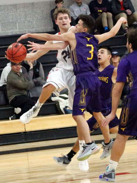 Aspen High School's Jonathan Woodrow, left, tries to pass against Basalt's Brian Granados on Saturday, Feb. 16, 2019, inside the AHS gymnasium. (Photo by Austin Colbert/The Aspen Times).