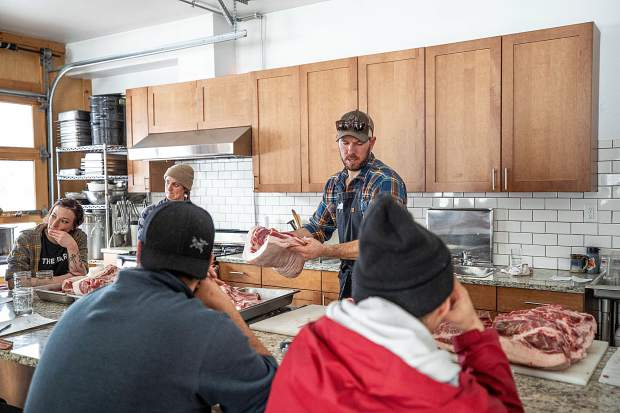 Rock Bottom Ranch Director Jason Smith butchers a pig Tuesday afternoon to educate Roaring Fork Valley chefs and employees from local grocers on how to not waste parts of the animal.
