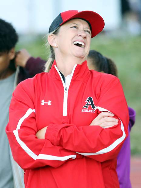 Aspen High School athletic director Martha Richards laughs duirng a 2017 football game against Middle Park.