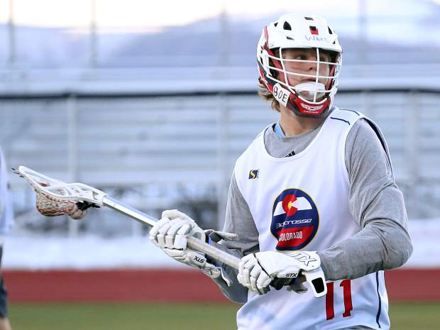 Aspen High School sophomore Tyler Ward runs through drills during boys lacrosse practice on Tuesday, Feb. 26, 2019, on the AHS turf.