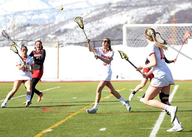 Aspen High School sophomore Kylie Kenny reaches out to haul in a pass during the girls lacrosse against Durango on Tuesday, March 19, 2019, on the AHS turf. (Photo by Austin Colbert/The Aspen Times).