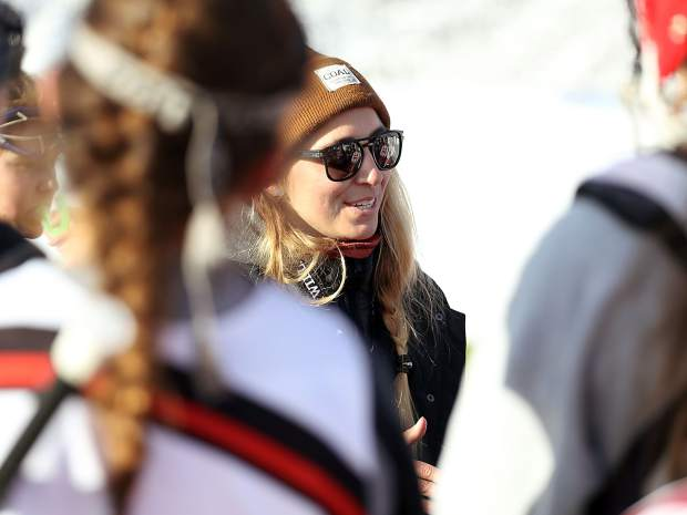 Aspen High School girls lacrosse coach Amanda Trendell talks to her team after practice on Monday, March 11, 2019, on the AHS turf. (Photo by Austin Colbert/The Aspen Times).