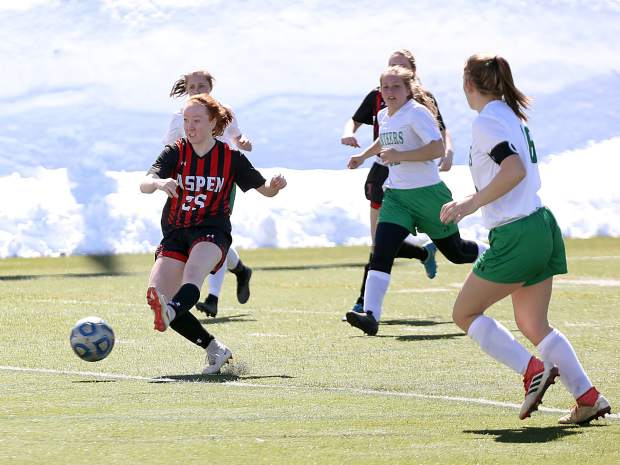 Aspen High School sophomore Kelley Francis shoots, and scores, in the girls soccer game against Delta on Saturday, March 16, 2019, on the AHS turf. (Photo by Austin Colbert/The Aspen Times).