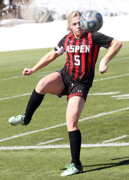 Aspen High School senior Margo McHugh corrals a loose ball in the girls soccer game against Delta on Saturday, March 16, 2019, on the AHS turf. (Photo by Austin Colbert/The Aspen Times).