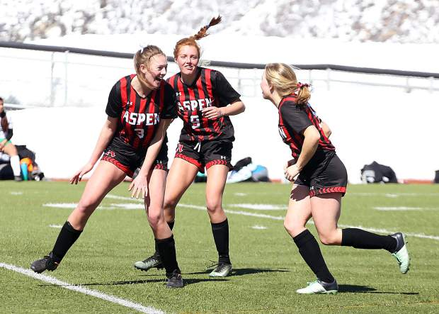 Aspen High School's Edie Sherlock, center, celebrates her goal with teammates in the girls soccer game against Delta on Saturday, March 16, 2019, on the AHS turf. (Photo by Austin Colbert/The Aspen Times).